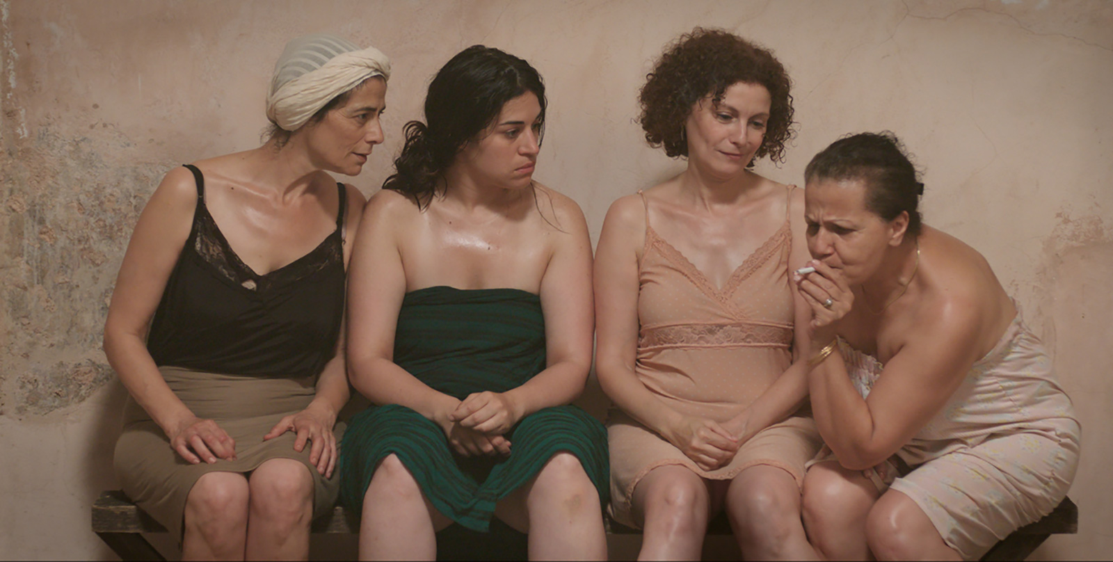 A film still of women in a public bath.