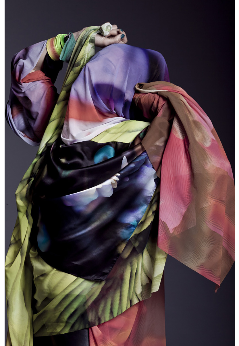 A figure is draped in scarves.