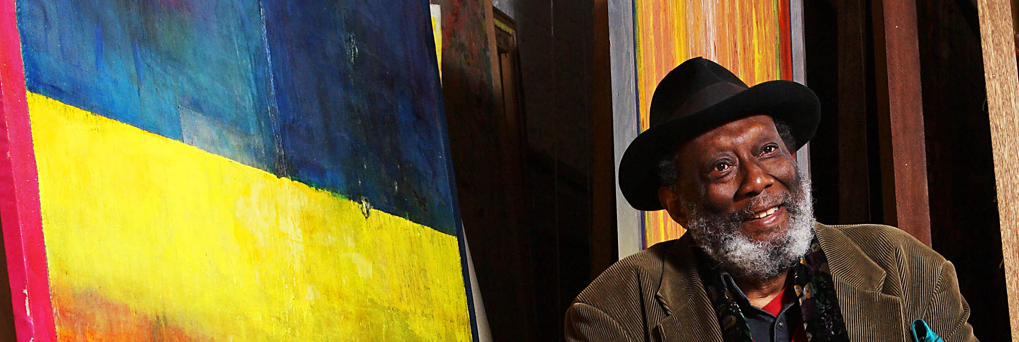 Portrait of Frank Bowling in his studio