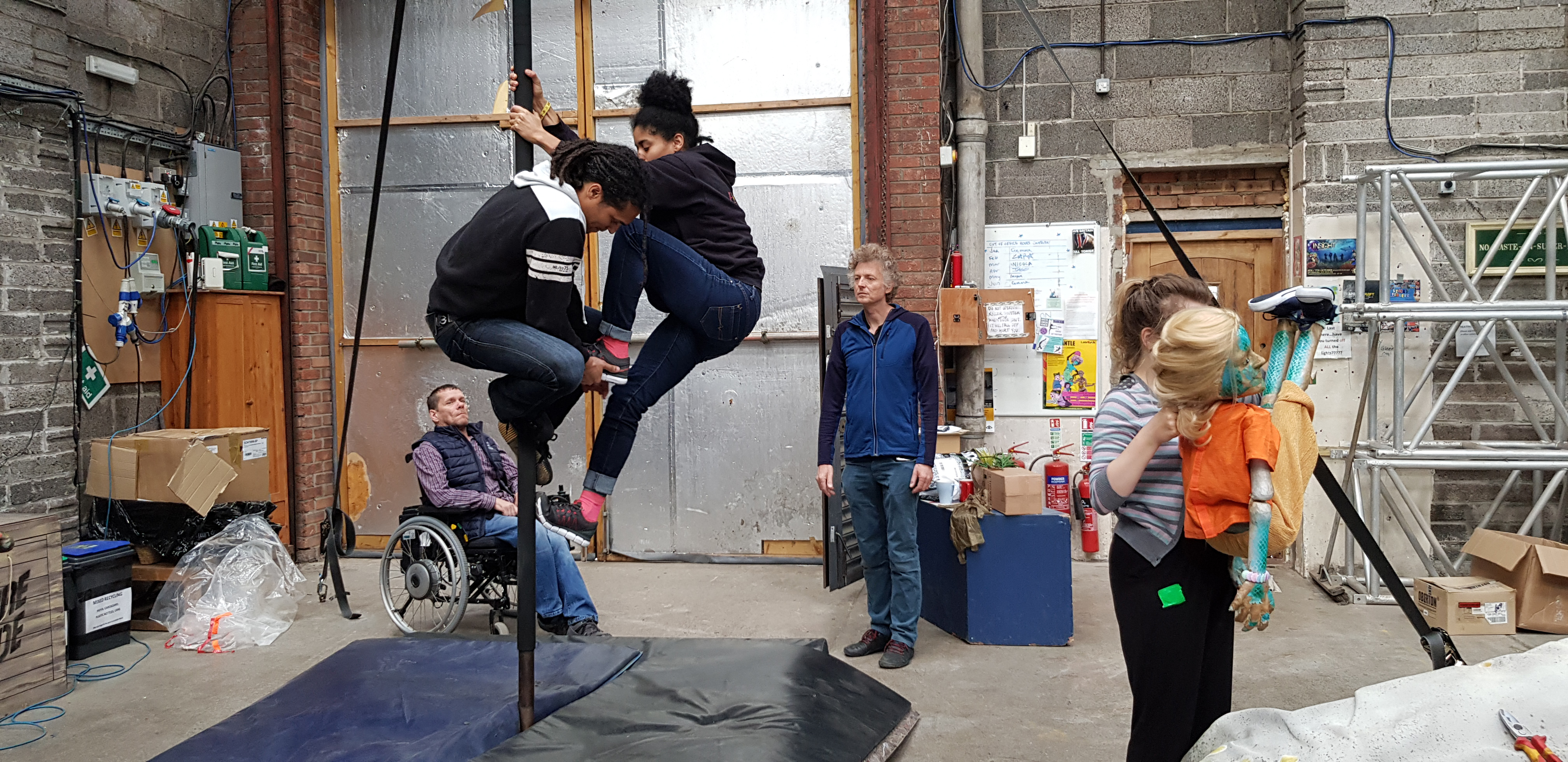 People in a studio practicing a performance