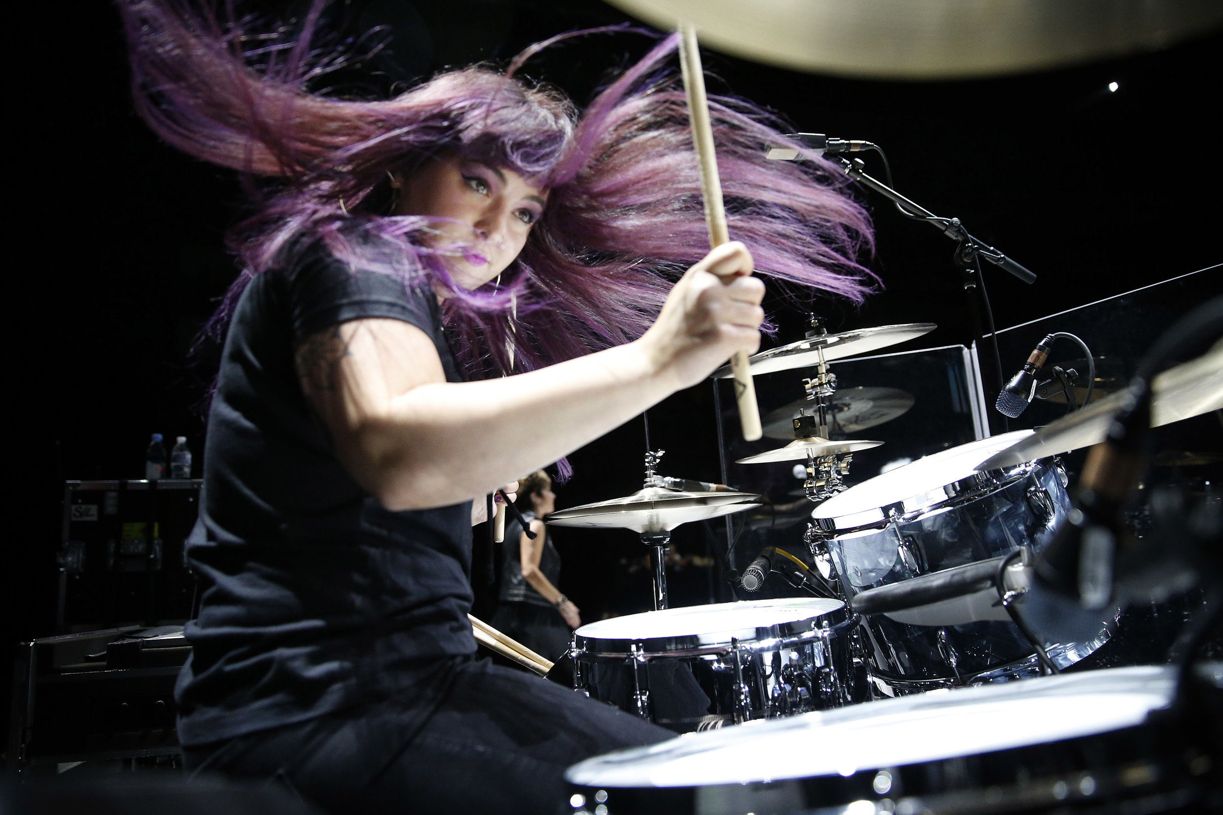 Girl plays on drums