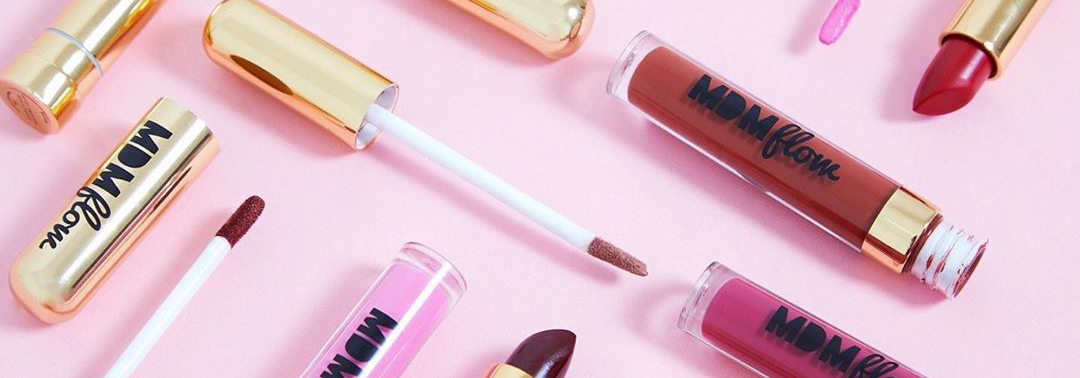 Combination of different colourful lipsticks on pink background