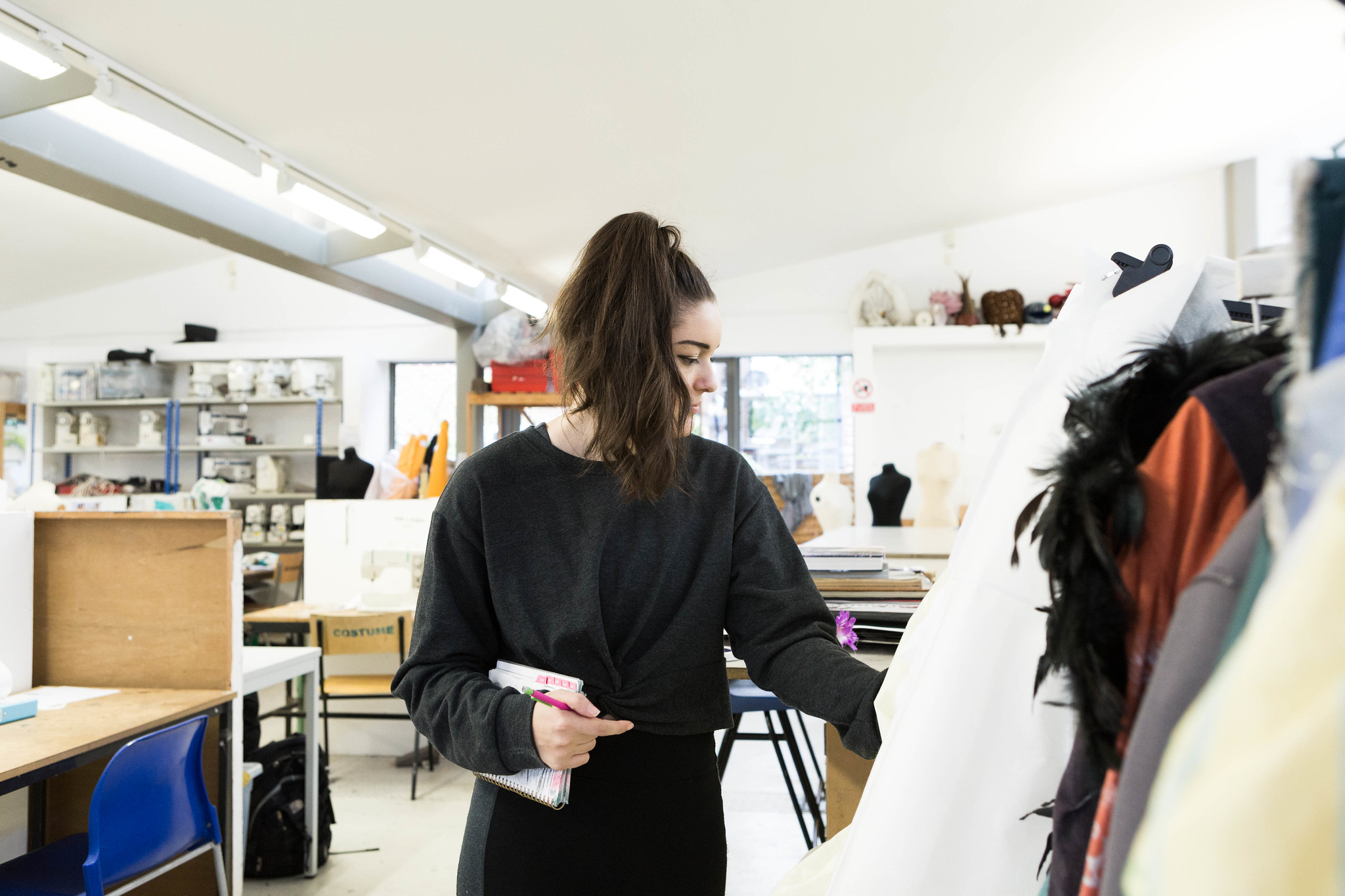 Girl arranges garments
